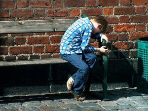 970752_sad_young_boy_on_the_bank.jpg